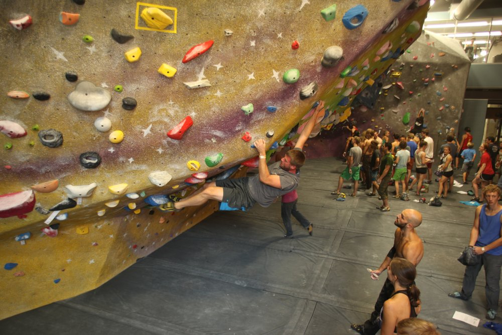 Man climbing at the indoor High Point Climbing & Fitness