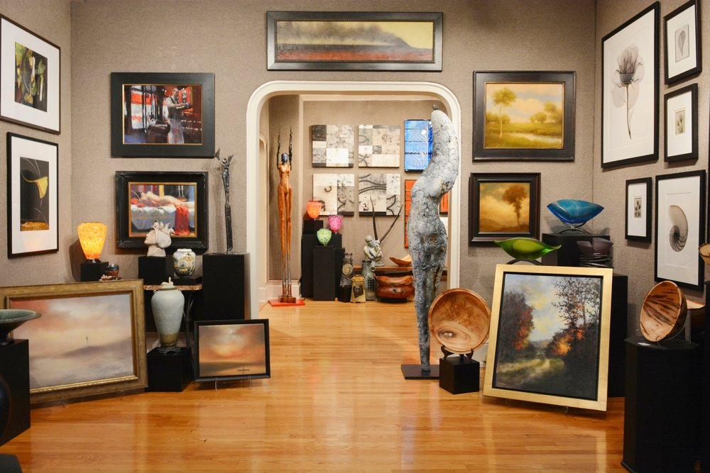 Gallery with frames and artwork on the walls