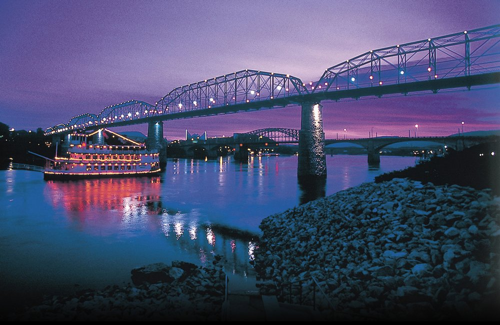 Southern Belle Riverboat in Chattanooga on the river at night by the bridge