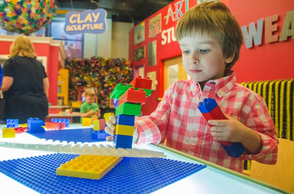 Child playing with legos at the Creative Discovery Museum