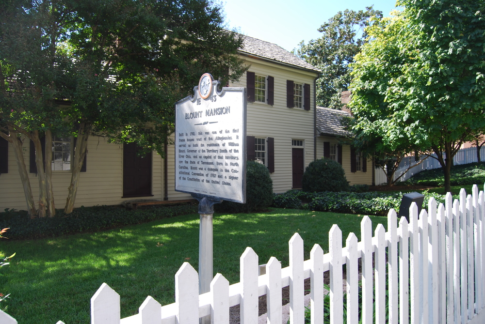 exterior of historic home in Knoxville with white picket fence