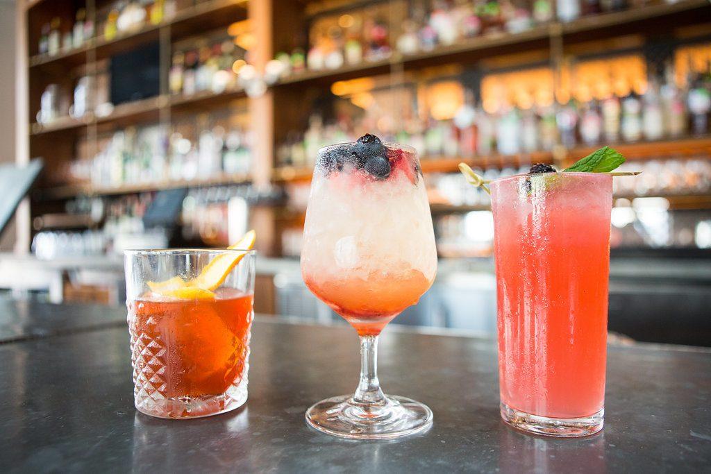 pink and orange cocktails a bar