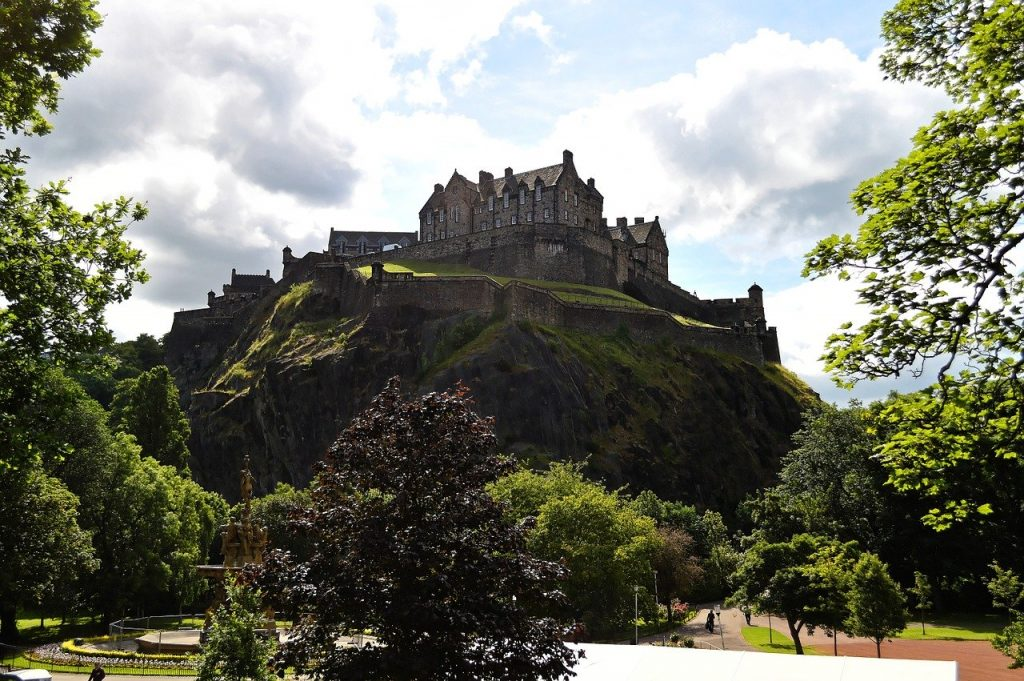 edinburgh castle sitting in the distance is one of the best things to see in scotland