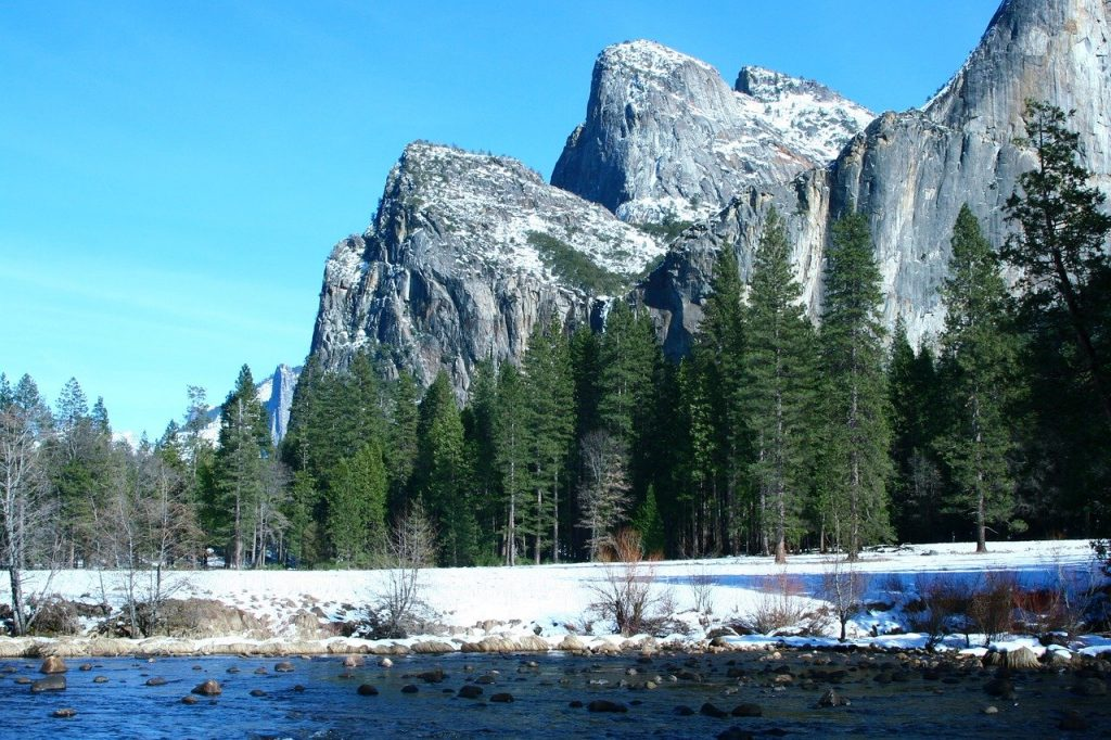 yosemite in the winter with snow on the ground