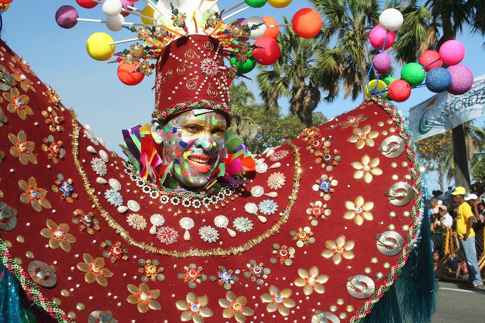 man dressed up in costume and face paint for carnaval in the Dominican republic