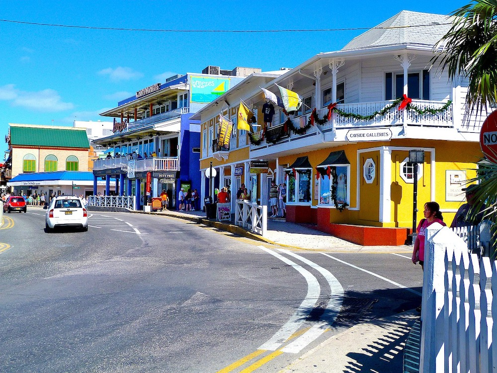 street in Grand Cayman with colorful shops and storefronts
