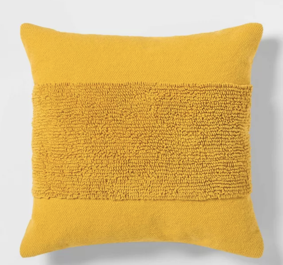 Yellow tufted throw pillow