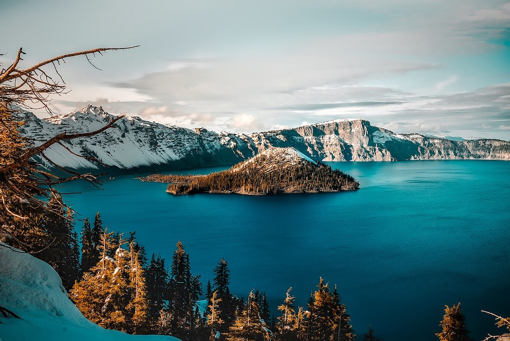 Crater Lake with snow capped mountains